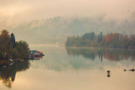 Floating homes on the Willamette River in Oregon City during a foggy fall day