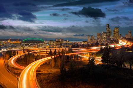 Seattle Washington city skyline and freeway during sunset blue hour Stock Photo