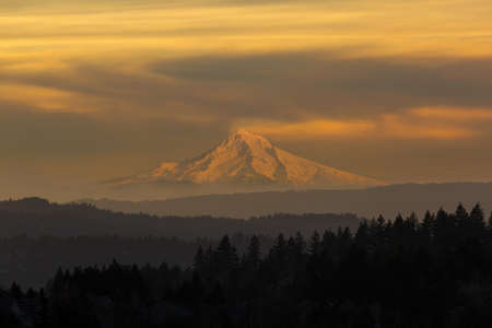 Mount Hood view from Happy Valley Oregon during a hazy sunset day in winter season Stock Photo