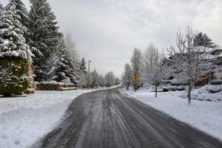 Plowed Salted de-iced street in North American suburban neighborhood Happy Valley Oregon Stock Photo