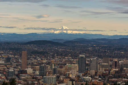 Mount Hood view over downtown Portland cityscape in the afternoon during winter Stock Photo