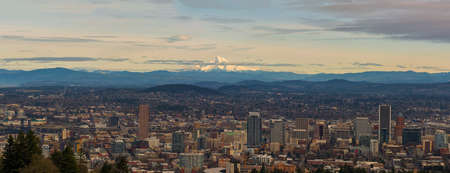 Mount Hood view over downtown Portland cityscape in the afternoon during winter panorama Stock Photo