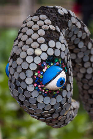st kilda: An abstract sculpture of a birds head covered in colorful sequins. Stock Photo