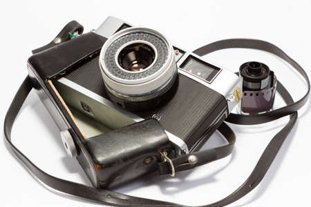 rangefinder: An old rangefinder camera with a film role.