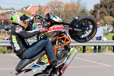 stunt: VICTORIAAUSTRALIA - SEPTEMBER 2015: Stunt motorcycle rider performing at a local car show on the 13 September 2015 in Corowa.