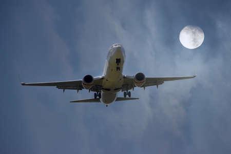 aircraft landing: An Aircraft landing with full moon.
