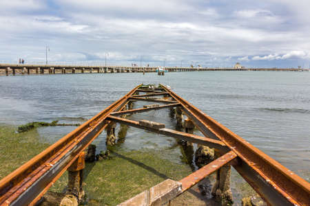 slipway: St Kilda Pier with an old boat slipway in the foreground. St Kilda, Australia