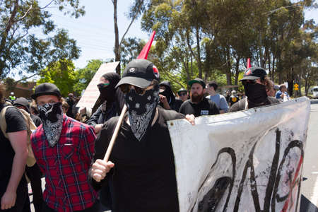 rallying: MELTON, VICTORIAAUSTRALIA - NOVEMBER 2015: Anti Racism protesters violently clashed with reclaim australia groups rallying agsint Mulsim immigration. Editorial