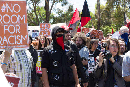 anarchist: MELTON, VICTORIAAUSTRALIA - NOVEMBER 2015: Anti Racism protesters violently clashed with reclaim australia groups rallying agsint Mulsim immigration. Editorial