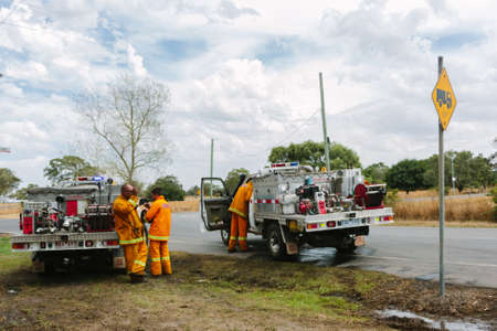 swept: EPPING, AUSTRALIA - 20 DECEMBER 2015: A day after fires swept through Epping in Melbourne, CFA Fire Crews patrol the area for spot fires as Melbourne Suffered its hottest day in December hitting 45 degrees C. Editorial