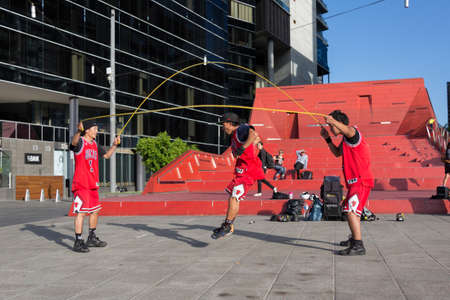busker: MELBOURNEAUSTRALIA - JANUARY 22: Street performers entertaining crowds in Southbank during the 2016 Australian Open tennis tournament. Editorial
