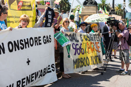 protesters: MELBOURNEAUSTRALIA - FEBRUARY 9: Anti CSG protesters gather outside Parliament house in Melbourne to rally against Coal Seam Gas mining on February 9 - coinciding with the opening of Parliament. Editorial