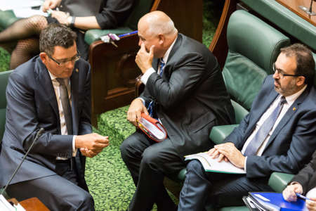 ministers: MELBOURNEAUSTRALIA - FEBRUARY 9: State Premier, Daniel Andrews discusses tactics with his senior ministers in question time, as parliament resumes in 2016.