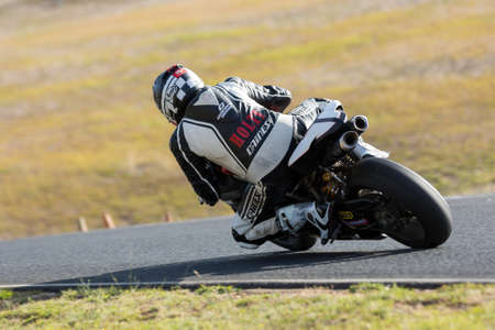 accelerated: BROADFORD, VICTORIAAUSTRALIA - MARCH 13: A mix of road and race bikes tussle against each other at The Broadford Motorcycle Complex.