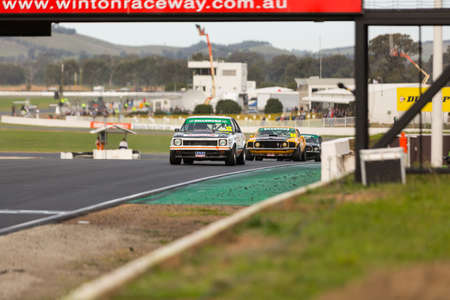 cars race: MELBOURNE, WINTONAUSTRALIA, 22 MAY , 2016: Classic race cars coming into turn 1 at Winton.