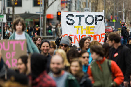 detention: MELBOURNEAUSTRALIA - 30 JULY , 2016: Protesters rally against the torture and detention of indigious childtren in the Northern Territory. The rally was held outside the State Library.