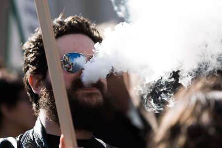 anti smoking: MELBOURNEAUSTRALIA - AUGUST 16, 2016: Protesters from the New Nicotine Alliance held a rally outside the Victorian Parliament house on Tuesday in time for Question Time.