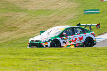MELBOURNE/AUSTRALIA - SEPTEMBER 10, 2016: Mick Benton behind the wheel of the MARC Cars Australia MARC Focus V8 for Race 1 at Round 6 of the Shannon's Nationals at Phillip Island GP Track in Victoria, Australia 9-11 September.