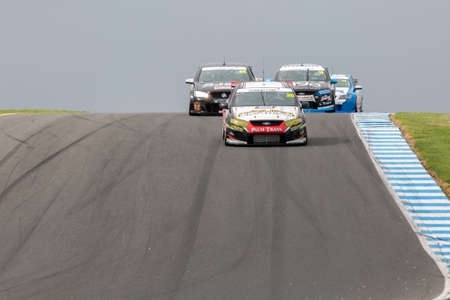 cars race: MELBOURNEAUSTRALIA - SEPTEMBER 10, 2016: Kumho Tyre V8 Touring Cars coming into turn 10 for race 1 at Round 6 of the Shannons Nationals at Phillip Island GP Track in Victoria, Australia 9-11 September.
