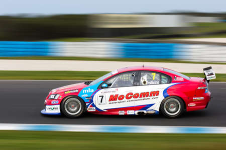 cars race: MELBOURNEAUSTRALIA - SEPTEMBER 10, 2016: Jim Pollicina behind the wheel of the MoComm Motorsports Communications Commodore for qualifying at Round 6 of the Shannons Nationals at Phillip Island GP Track in Victoria, Australia - 9-11 September. Editorial