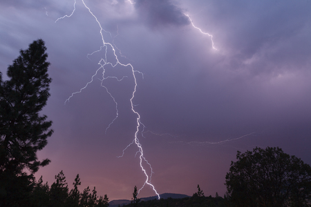severe weather: Lightning bolt strikes in this spectacular late evening shot, Oregon, Ashland, Cascade Siskiyou National Monument