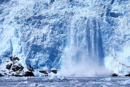 Holgate Glacier calving with icebergs falling and splashing into the sea, Alaska, Seward, Kenai Fjords National Park