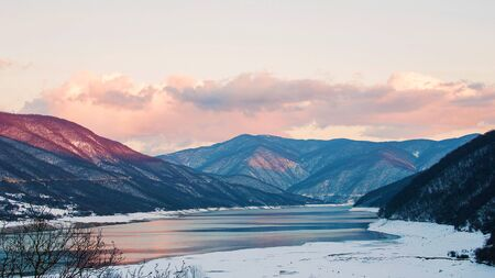 Vedzathevi river empties into the river Aragvi. Winter sunset gives unusual and interesting lighting mountains and water.