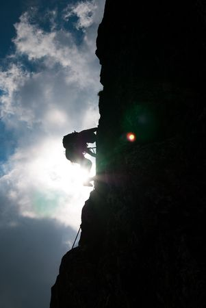 A silhouette of a climber into a beautiful afternoon in National-Park Retezat, Romania, Bucura cliff