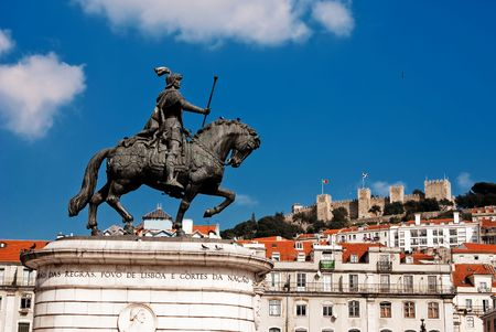 Statue of King Joao I at Figueiroa Square, and St. Jorge castle in Lisbon, Portugal Reklamní fotografie