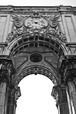 The famous Triumph Arch of Augusta Street in Lisbon, Portugal, next to Commerce Square photo