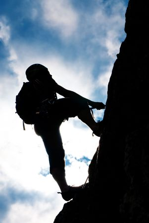 to climb: Silhouette of a man during an ascension in Retezat mountains.
