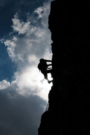 Silhouette of a man during an ascension in Retezat mountains. 免版税图像 - 7526105