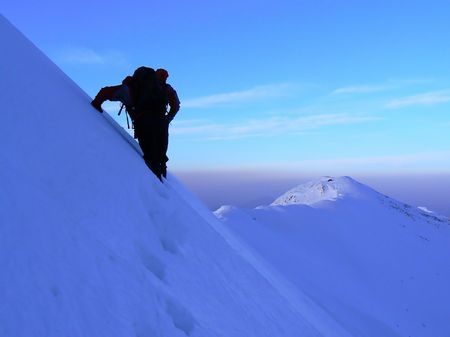 Ice climbing in Piatra Craiului mountains in winter. photo