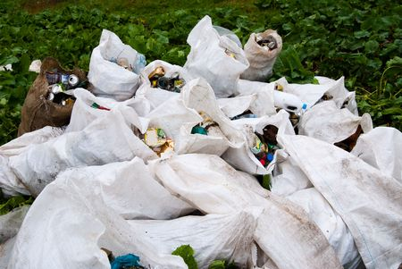 Image of bags full of garbage after a campain of cleaning forest in Fagaras mountain, Barcaciu shelter photo