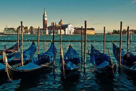 Gondolas anchored on Grand Canal in Venice  photo