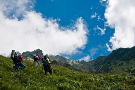Hikers in Fagaras mountain, in ascension, to the ridge.