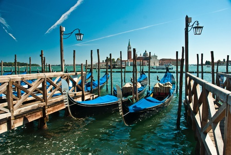 venecian: Gondolas anchored on Grand Canal in Venice  Stock Photo