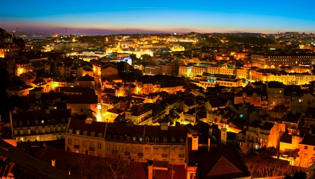 A panorama over Alfama District in Lisbon - night view