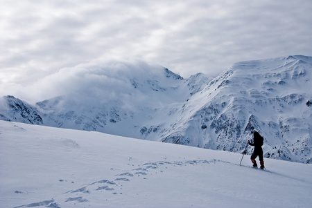 A landscape from Barcaciu with a trekker girl and Scara edge in Fagaras mountains photo