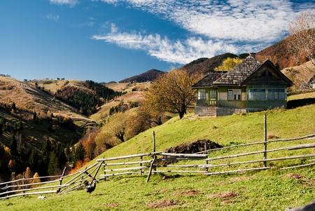 Autumn landscape in an alpine village (Romania) photo