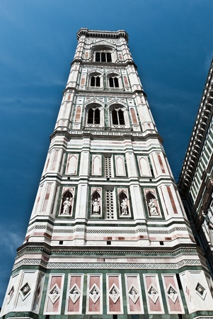 The Campanile, or Giottos Bell Tower, in Florence, is part of the Duomo complex, Tuscany photo
