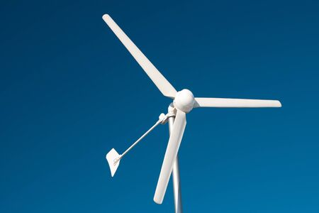 eolian: Single isolated and rotating wind turbine  Eolian power Stock Photo