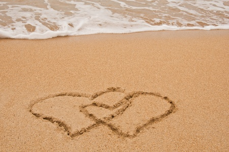 Photo of beach and love in sand. photo