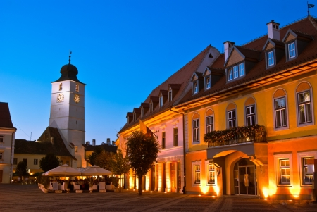 Main square and council tower in Sibiu, Romania at blue hour Medieval constructions
