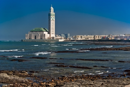 The Hassan II Mosque, located in Casablanca is the largest mosque in Morocco and the third largest mosque in the world after the Grand Mosque of Mecca and the Prophet's Mosque in Medina.  Фото со стока