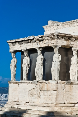 The Caryatids female statues with veils in the Erechteion temple ruins, Acropolis, Athens, Greece photo