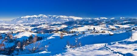 Winter rural landscape in Romania, Sirnea village, Carpathian mountains (Bucegi) Stock Photo
