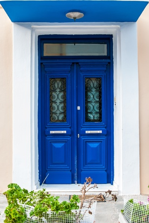 Impressive Greek blue front door in Katakolon photo