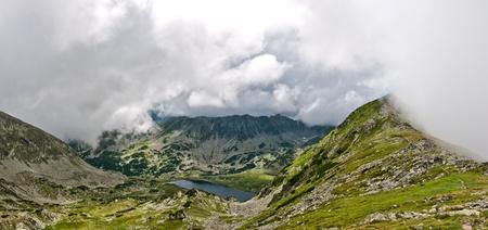 Landscape of an alpin lake in Retezat mountains, seen from the ridge. Stock Photo - 15783925