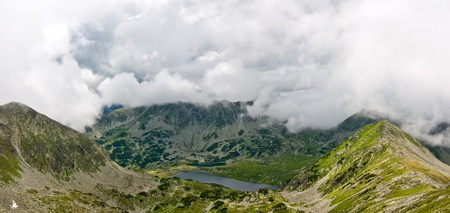 Landscape of an alpin lake in Retezat mountains, seen from the ridge. Stock Photo - 15789505